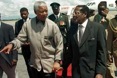 Former South African president Nelson Mandela and Zimbabwean President Robert Mugabe.