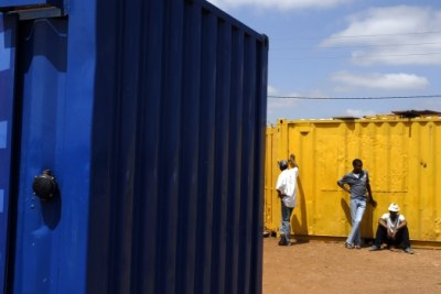 Unemployed young men in Mamelodi, South Africa wait for an offer of casual labour next to businesses that are trading out of converted shipping containers (file photo).