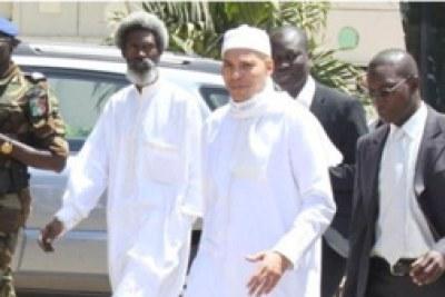Karim Wade en compagnie de ses avocats