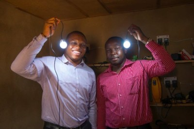 (L-R): Executive Director Chuka Eze and CEO Ifeanyi Orajaka, of Green Village Electricity Project (GVE) demonstrate how their innovative technologies can illuminate households and increase productivity in remote areas.