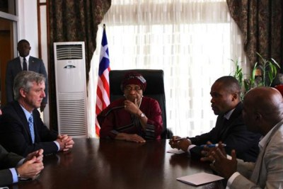 Head of the UN Mission for Ebola Emergency Response (UNMEER), Anthony Banbury (left) meeting with the President of Liberia Ellen Johnson-Sirleaf (to his left) in the capital Monrovia.