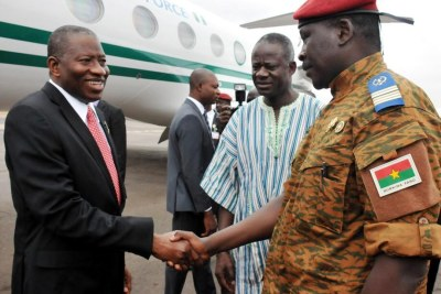President Goodluck Jonathan of Nigeria greets interim Head of State of Burkina Faso, Lt. Col Isaac Zida in Ouagadougou.