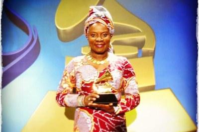 Angelique Kidjo holding her second Grammy.