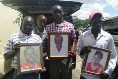 A family from Elgeyo Marakwet holding the pictures of their three children who died during the Garissa terror attack (file photo).