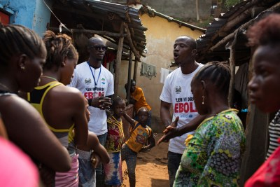 Volunteers go door-to-door telling residents of Freetown how to prevent the virus (fie photo).