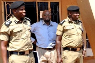 The late Kibuli-based Muslim faction spokesperson Sheikh Hassan Kirya, centre, with the Commandant of VIPPU, Mr Elias Kassirabo, left,  and his deputy Anthony Ntungwa, right (file photo).