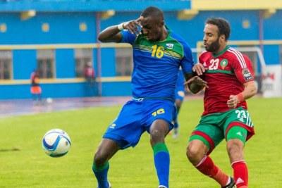 Amavubi forward Ernest Sugira, shields the ball from Morocco defender Issam Erraki on Sunday. Rwanda lost the game 4-1.