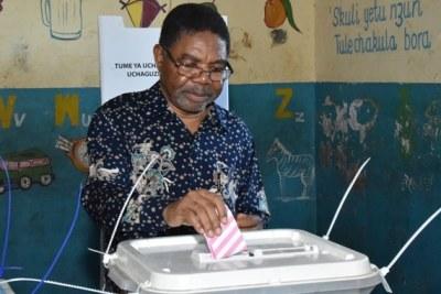 Zanzibar president Ali Mohamed Shein casts his vote at Bungi village, South Unguja Region.