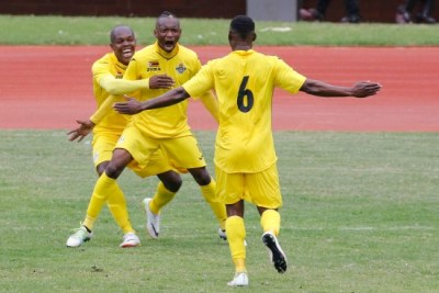 Khama Billiat celebrates with team mates after scoring.