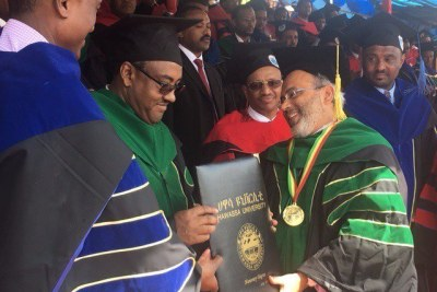 (From Left) Ethiopia's Deputy Prime Minister, Ato Demeke Mekonene, conferring a honorary doctorate of Development Studies by one of Ethiopia's leading higher institution of learning, Hawassa University, on Executive Secretary of the Economic Commission of Africa, Carlos Lopes,  in recognition of Lopes' leadership and intellectual contribution to Africa's development on the continent and beyond.