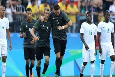 Germany players celebrate after scoring against Nigeria.