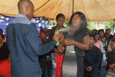 Prophet Lethebo Rabalago sprays Doom at a member of his congregation (file photo).