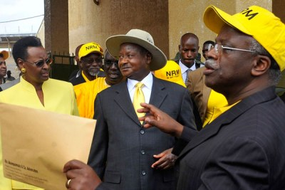 Mending fences. President Museveni (centre) with the First Lady Janet Museveni chat with the former prime minister and NRM secretary general Amama Mbabazi after the 2011 presidential election nominations at Namboole stadium.