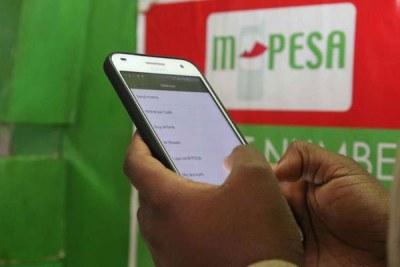 Using the the M-Pesa money transfer service (file photo).