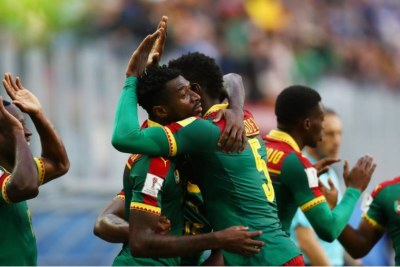Cameroon players celebrating a goal