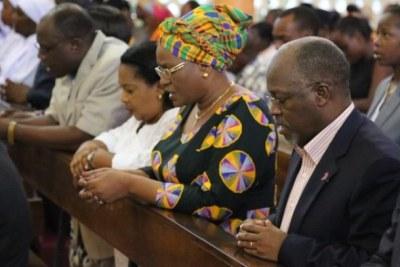 President John Magufuli in church during a service.