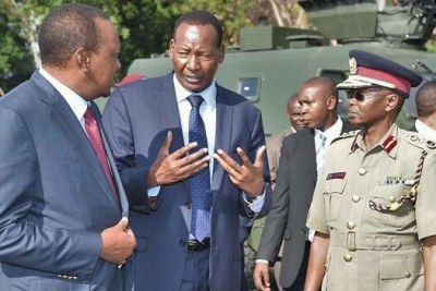 Joseph Nkaissery with President Uhuru Kenyatta, Principal Secretary Karanja Kibicho and Inspector General Joseph Boinnet, when the Head of State commissioned the Armoured Personnel Carriers.