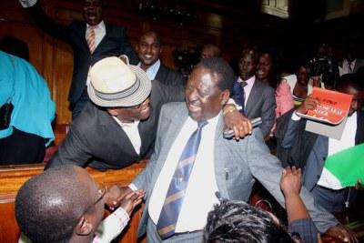 Raila Odinga celebrates the Supreme Court's decision with other National Super Alliance leaders.