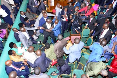 MPs fight in Parliament after trading accusations of smuggling a gun in the House during plenary on September 26, 2017.