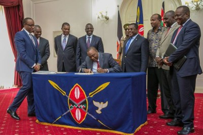 President Uhuru Kenyatta signs Supplementary budget in to law in at State House, Nairobi on October 13, 2017.