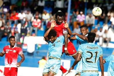 Kenya's Kepha Aswani (centre) vies for an aerial ball with Zanzibar's Yahya Mudathir during their Cecafa Senior Challenge Cup match on December 9, 2017 at Kenyatta Stadium, Machakos.