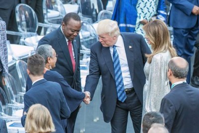 President Trump greets Kenya's First Lady Margaret Kenyatta at the 43rd G7 Summit in Italy.
