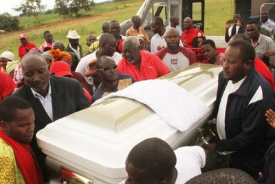 Pallbearers carry the casket bearing the body of former Prime Minister and MDC-T leader Morgan Tsvangirai at Makanda Primary School, Humanikwa Village, in Buhera.