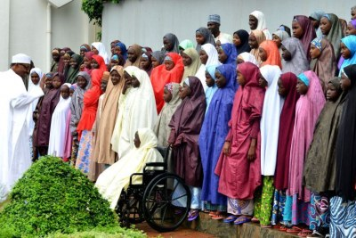 President Muhammadu Buhari, left, with the released Dapchi schoolgirls at a ceremony at the presidential villa in Abuja on Friday March 23, 2018,