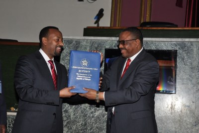 Hailemariam handing over the constitution to the incoming Premier