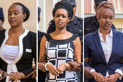 Adeline Rwigara (left) and her daughters Diane Rwigara (centre) and Anne Rwigara are escorted by security officers to a police van after a Kigali court adjourned the pre-trial hearing in which they are facing criminal charges on October 9, 2017.