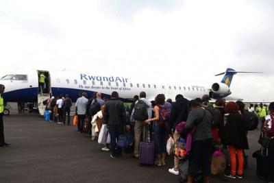 Passengers board a RwandAir plane.