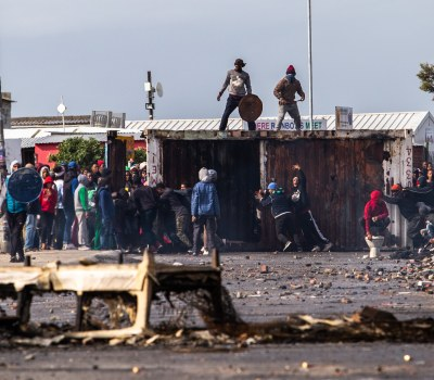 Photo Essay - Running Battles Over Land Occupation in Vrygrond, Cape Town