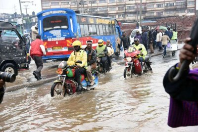 Motorcyclists ride through a flooded section of a road in Nairobi (file photo).