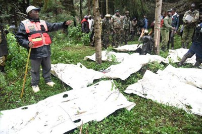 Rescue teams prepare bodies of FlySax plane crash victims for transportation from the Aberdares on June 7, 2018.