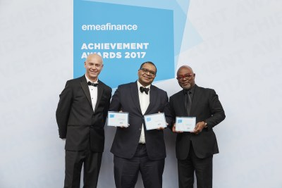 Andrew Alli (center) and Oliver Andrews (right) receive Champion of Finance Award from Christopher Moore, CEO and Publisher of EMEA Finance.
