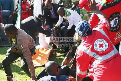 First aiders attend to the injured following an explosion that rocked White City Stadium where President Emmerson Mnangagwa was addressing thousands of Zanu-PF supporters (file photo).