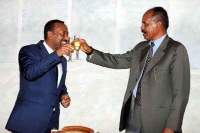 Ethiopia's PM Abiy Ahmed and Eritrea's President Isaias Afewerki at an official dinner in Asmara (file photo)