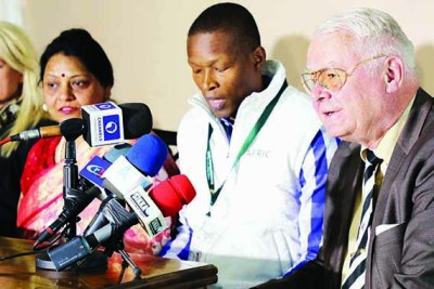 AFRIC observer mission group member Volker Tschapke, right, addresses the media while flanked by Professor Jose Matemulane and Purnima Anad, third from right, and Mirjam Katharina Zwingli in Borrowdale, Harare.