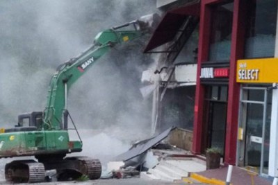 A bulldozer pulls down a section of Java House and Shell petrol station in Kileleshwa on August 6, 2018.