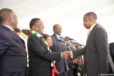 President Emmerson Mnangagwa congratulates the new Finance and Economic Development Minister Mthuli Ncube while flanked by Vice Presidents Constantino Chiwenga (left) and Kembo Mohadi at State House (file photo).