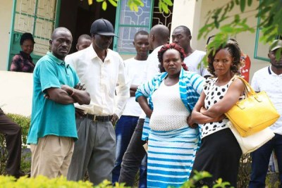 Sharon Otieno's parents Douglas Otieno (in black cap) and Melida Auma (second right) with their relatives at Homa Bay where Migori Governor Okoth Obado's personal assistant Michael Oyamo was to be arraigned over the abduction and murder of their daughter in the picture taken on Tuesday September 11, 2018.