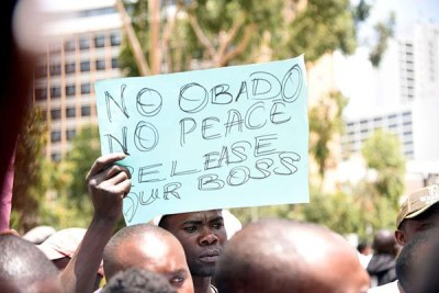 Migori Governor Okoth Obado's supporters protest outside Milimani Law Courts, where he pleaded not guilty to murder charges, on September 24, 2018.