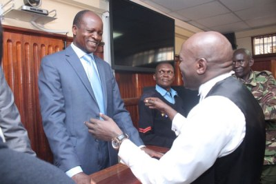 Migori Governor breaks into a smile as he speaks with his lawyer at the High Court in Nairobi shortly after he was freed on bond in Sharon Otieno murder case.