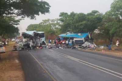 The wreckage of Bolt Cutter and Smart Express buses that collided head-on on the Harare-Mutare Highway, killing 47 people and leaving 70 others injured.