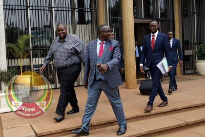 Harare businessman Wicknell Chivayo, left, with his lawyers (file photo).