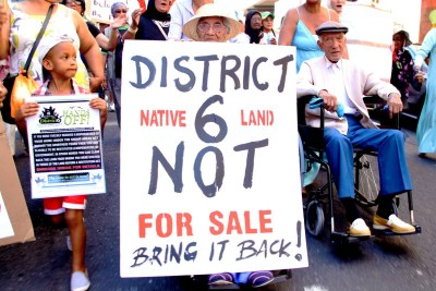 Yasiem Beckles, 4, Catherine Wagner, 91, and Cyril Wagner, 92, lead a march of land claimants from District Six to the Civic Centre (file photo).