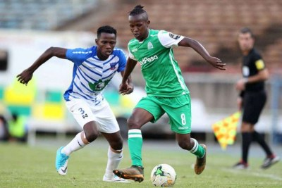 Gor Mahia midfielder Francis Kahata (right) shields the ball from Chidiedube Duru of Lobi Stars during a Caf Africa Champions League match in Nairobi on December 16, 2018.