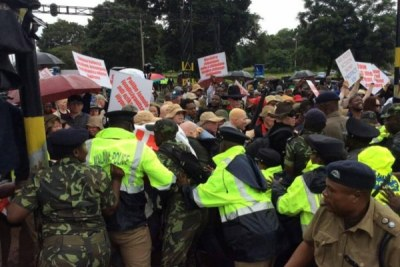 Police block APAM demonstrators from reaching State House.