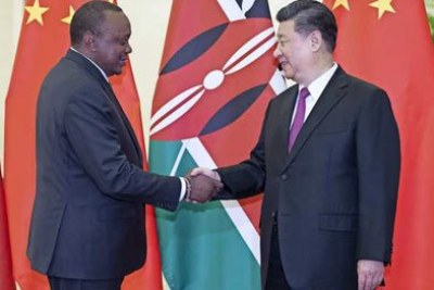 President Uhuru Kenyatta (left) greets Chinese President Xi Jinping at the Great Hall of the People in Beijing on April 25, 2019 ahead of the second Belt and Road Forum for International Cooperation.