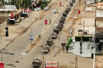 RSF vehicles patrol the empty streets of Khartoum.